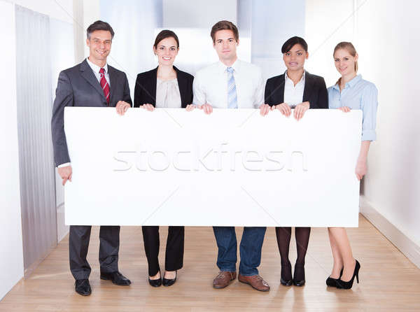 Businesspeople Holding Blank Placard Stock photo © AndreyPopov