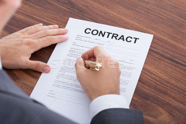 Affaires signature contrat table image papier Photo stock © AndreyPopov