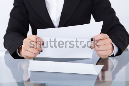 Businesswoman Giving Papers Stock photo © AndreyPopov