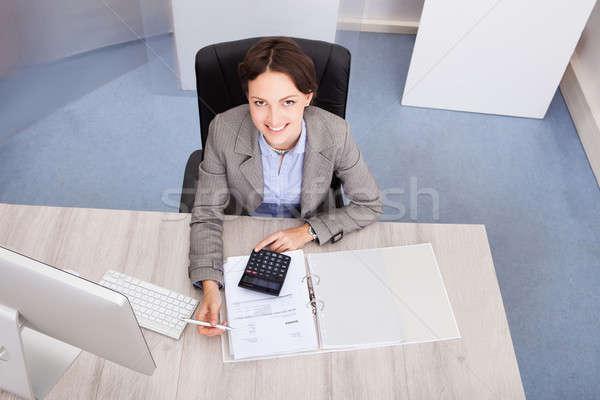 Feliz feminino contador retrato sorridente jovem Foto stock © AndreyPopov