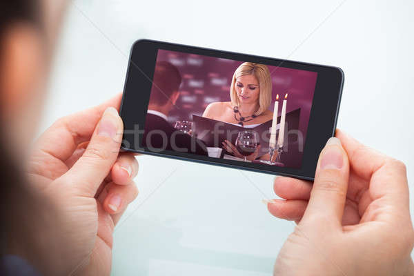 Person Watching Video On Cellphone Stock photo © AndreyPopov