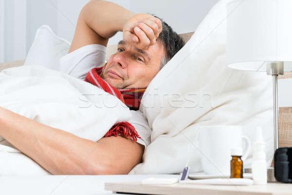 Krank reifer Mann Bett Schlafzimmer Mann medizinischen Stock foto © AndreyPopov