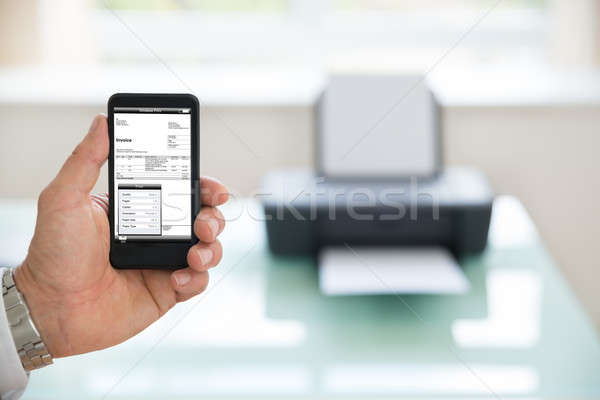 Person Using Cellphone For Printing Invoice Stock photo © AndreyPopov