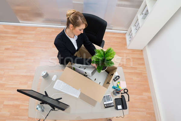 Businesswoman Packing Belongings In Office Stock photo © AndreyPopov