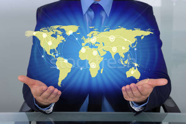 Businessman With World Map Stock photo © AndreyPopov