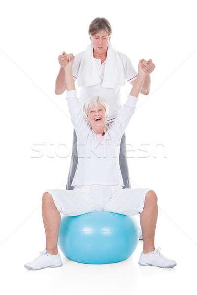 Couple de personnes âgées pilates balle heureux blanche Photo stock © AndreyPopov
