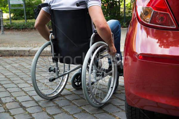 Disabled Man Sitting On A Wheelchair Near His Car Stock photo © AndreyPopov