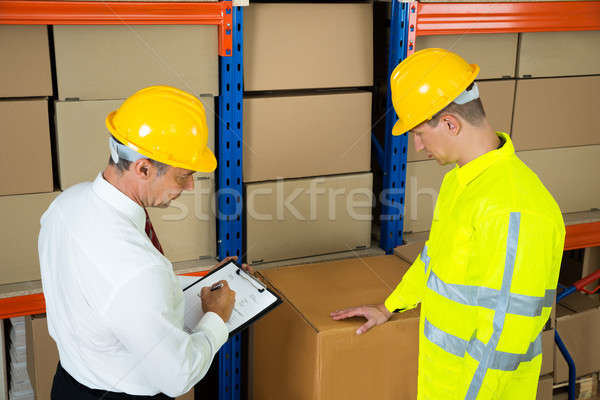 Warehouse Worker Checking The Inventory With Manager Stock photo © AndreyPopov