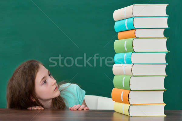 Afraid Girl Looking At Colorful Books Stock photo © AndreyPopov