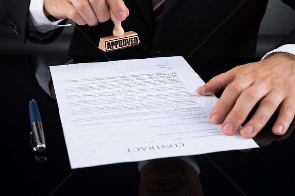 Businessperson Approving Contract Paper Stock photo © AndreyPopov