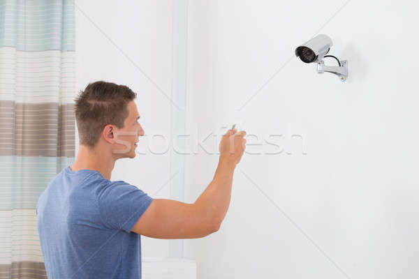 Man Operating Security Camera Stock photo © AndreyPopov