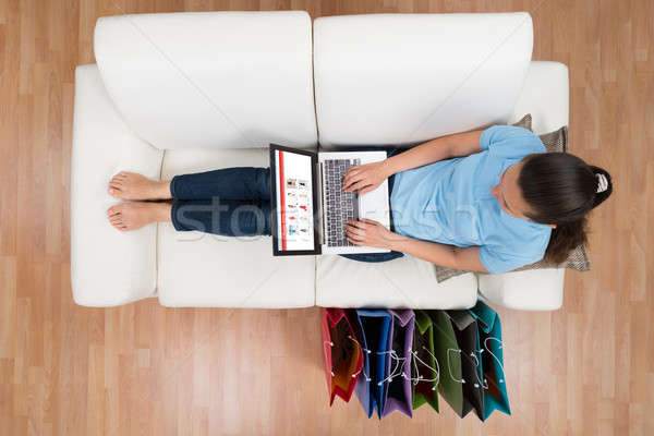 Woman Browsing Shopping Site On Laptop Stock photo © AndreyPopov