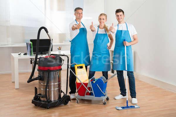 Aspirapolvere pulizia felice ufficio tecnologia Foto d'archivio © AndreyPopov