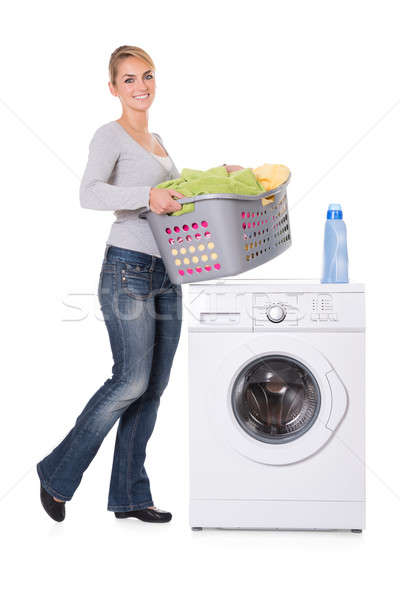 Woman With Detergent And Laundry Standing By Washing Machine Stock photo © AndreyPopov