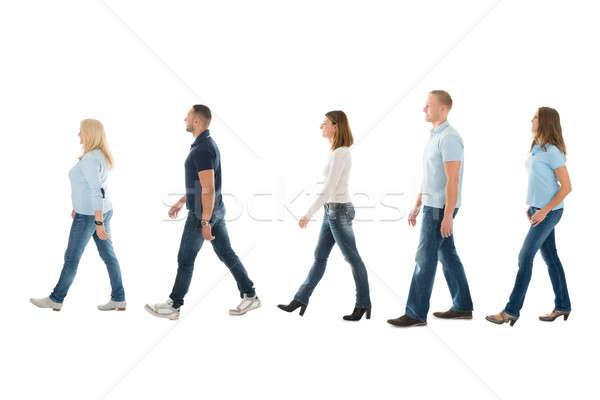 Vista laterale persone piedi coda uomini Foto d'archivio © AndreyPopov