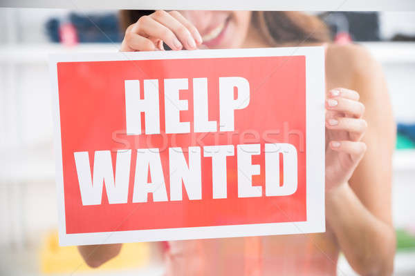 Owner Holding Help Wanted Sign In Retail Store Stock photo © AndreyPopov