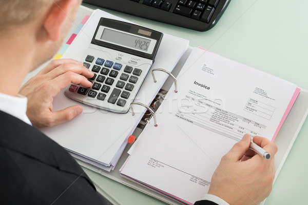 Zakenman belasting jonge kantoor werken Stockfoto © AndreyPopov