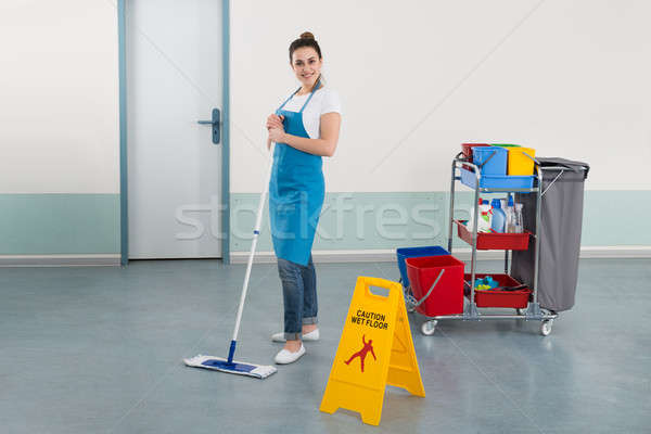 Female Janitor Mopping Corridor Stock photo © AndreyPopov
