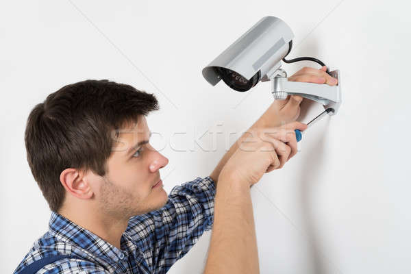 Technician Adjusting CCTV Camera Stock photo © AndreyPopov