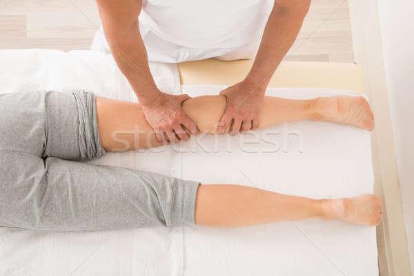 Therapeut Bein Massage Ansicht spa Stock foto © AndreyPopov