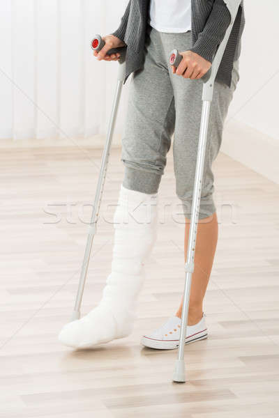 Woman Using Crutches While Walking Stock photo © AndreyPopov