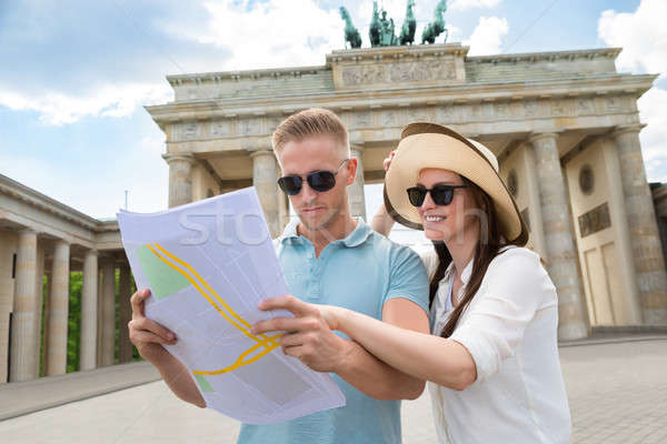 Young Couple Looking At Map Stock photo © AndreyPopov