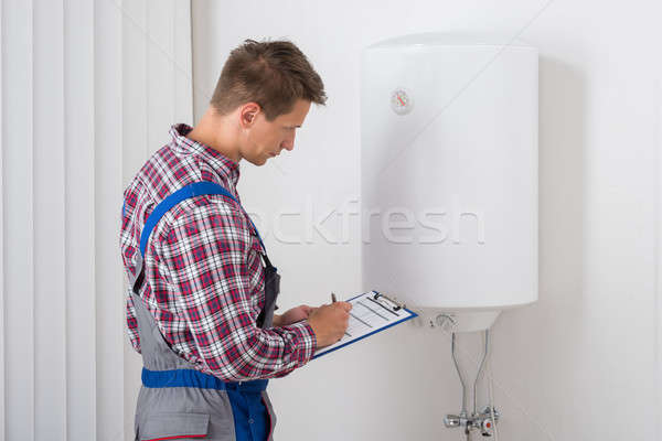 Plumber Checking Electric Boiler Stock photo © AndreyPopov