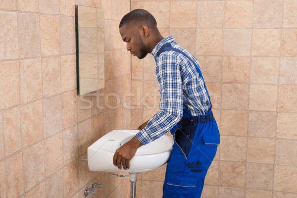 мужчины водопроводчика раковина ванную вид сбоку Сток-фото © AndreyPopov