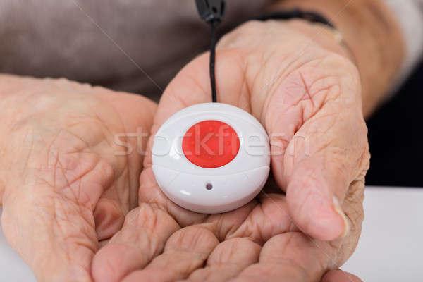 Senior Woman Holding Alarm Button Stock photo © AndreyPopov