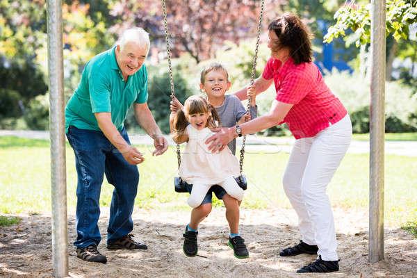 счастливым внучка Swing бабушка или дедушка старший дедушка и бабушка Сток-фото © AndreyPopov