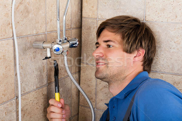 Plumber Repairing Electric Boiler With Wrench Stock photo © AndreyPopov