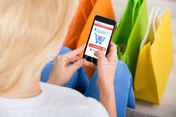 Woman Shopping Online Using Mobilephone Stock photo © AndreyPopov