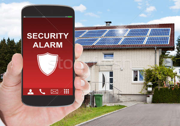 Person With Security Alarm On A Smartphone Stock photo © AndreyPopov