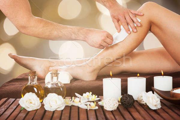 Terapeuta gyantázás női vásárlók láb közelkép Stock fotó © AndreyPopov