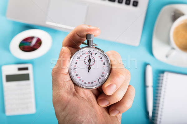 Person Stopping A Stopwatch Stock photo © AndreyPopov
