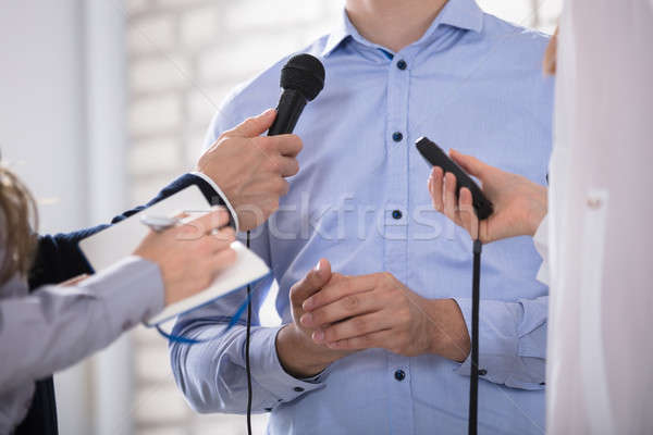 Man Speak Into The Mike In The Media Stock photo © AndreyPopov