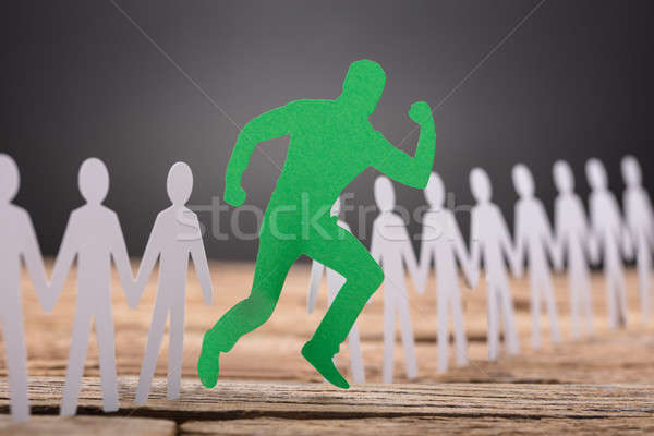 Green Paperman Standing Out Stock photo © AndreyPopov