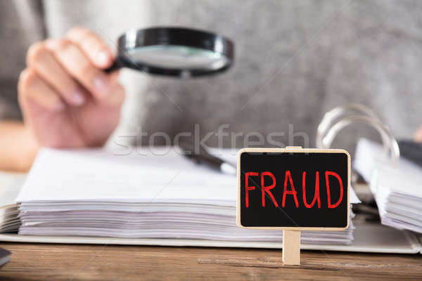 Fraud Small Board On Desk Stock photo © AndreyPopov