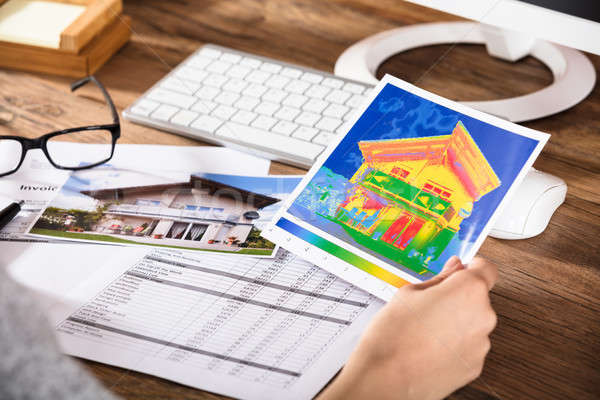 Stock photo: Person Analyzing The Thermal Image Of A House