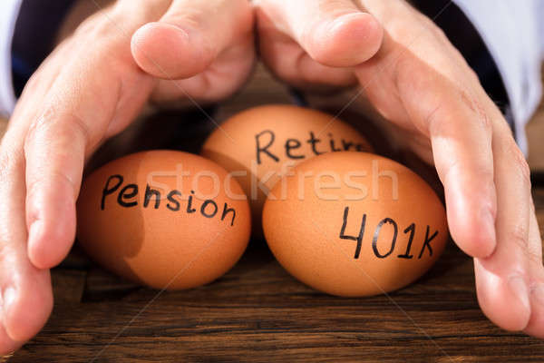 Person Protecting Egg Showing Pension And Retirement Text Stock photo © AndreyPopov