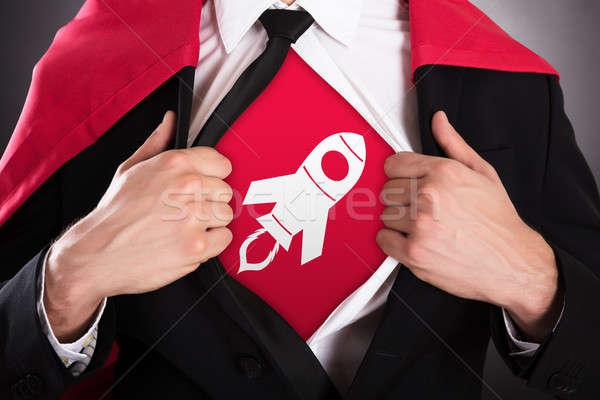 бизнесмен открытие пальто superhero стиль Сток-фото © AndreyPopov