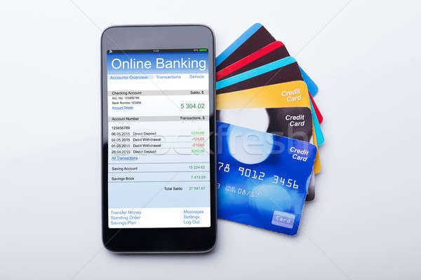 Mobilephone With Online Banking App And Credit Card Stock photo © AndreyPopov