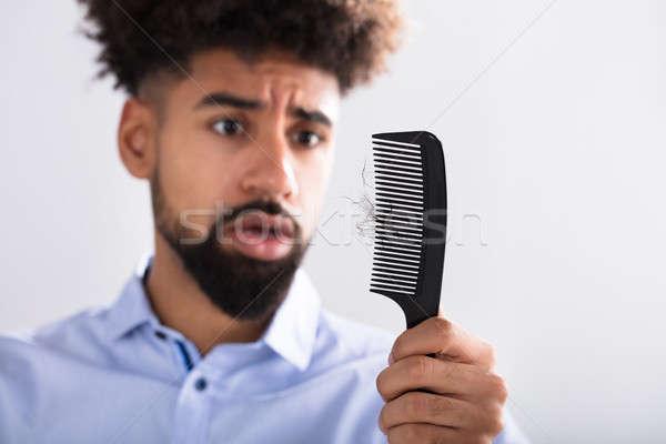Adam bakıyor saç kayıp genç Stok fotoğraf © AndreyPopov
