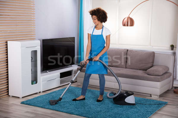 Janitor Cleaning Carpet With Vacuum Cleaner Stock photo © AndreyPopov