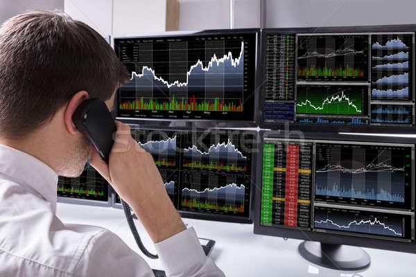 Stock courtier parler téléphone multiple Photo stock © AndreyPopov