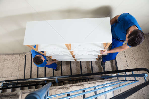 Two Men Carrying Shelf Stock photo © AndreyPopov