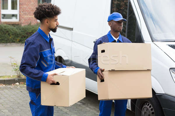 Two Men Holding The Cardboard Boxes Stock photo © AndreyPopov