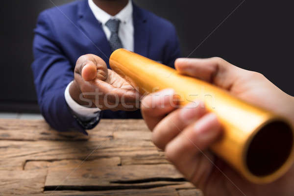 Businessman Passing Baton To His Partner Stock photo © AndreyPopov