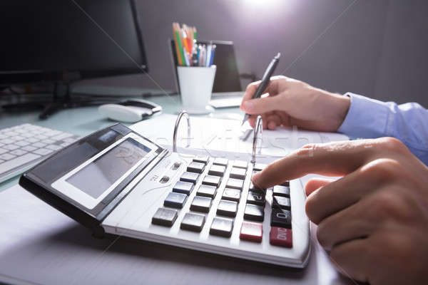 Businessperson Calculating Receipt With Calculator Stock photo © AndreyPopov