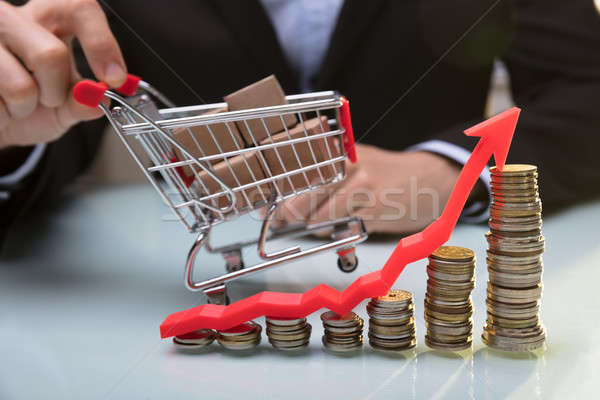 Close-up Of Stacked Coins And Arrow Showing Upward Direction Stock photo © AndreyPopov